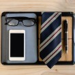 Businessman accessories and notebook bag on desk — Stock Photo #80048674