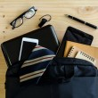 Businessman accessories and notebook bag on desk — Stock Photo #80689000