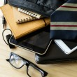 Businessman accessories and notebook bag on desk — Stock Photo #80689230