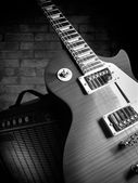 Guitar and amplifier — Stock Photo