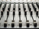 Mixing desk  faders and knobs — Stock Photo