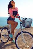 Beautiful sensual girl with dark hair with bicycle — Stock Photo