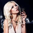 Portrait of sexy woman with blond hair with glass of champagne — Stock Photo #53476073