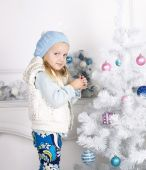 Cute little girl decorating Christmas tree — Stock Photo