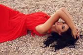Beautiful woman with dark hair in elegant red dress  — Stock Photo