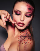 Sexy girl with extravagant make up for Halloween — Stock Photo