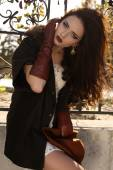 Beautiful ladylike woman with dark hair in elegant coat and leather gloves — Stock Photo