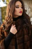 Portrait of sexy beautiful brunette woman in luxurious fur coat — Stock Photo