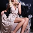 Sexy woman with blond hair with glass of champagne — Stok fotoğraf #57005467