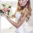 Portrait of beautiful bride in elegant dress with wedding bouquet — Stock Photo #60519931