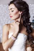 Beautiful elegant bride with dark hair posing at studio  — Stock Photo