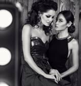Fashion black and white studio photo of two beautiful sensual women — Stock Photo