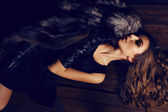 Woman with  dark hair in luxurious fur coat and leather gloves — Foto Stock
