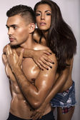 Sexy impassioned couple in jeans clothes   — Stock Photo