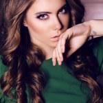 Beautiful woman with dark hair wearing elegant green dress — Stock Photo #64732731