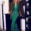 Blond woman in elegant  dress and fur coat posing in luxurious interior — Stock Photo #67578603