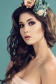 Woman with flower's headband — Stock Photo