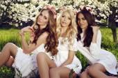 Charming girls in elegant dresses and flower's headband — Stock Photo