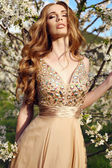 Sensual woman with long red hair in luxurious sequin dress  — Stock Photo