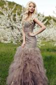 Sensual woman with long blond hair in luxurious sequin dress   — Stock Photo
