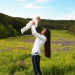 Beautiful mother having fun with her little cute baby in summer garden — Stock Photo #73414311