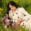 Beautiful mother having fun with her little cute baby in summer garden — Stock Photo #73414317