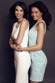 Beautiful charming girls with dark hair in elegant dresses — Stock Photo