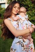 Like mother like daughter. beautiful family in similar dresses   — Stock Photo