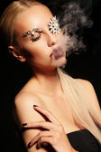 Sexy blond woman with fantastic makeup with bijou accessories — Stock Photo