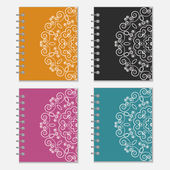 Set of colorful notebook covers with flower design — Stock Vector