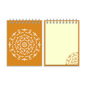 Spiral orange cover notebook with round ornate pattern — Stock Vector