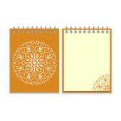 Orange cover notebook with round florwer pattern — Stock Vector