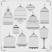 Set of silhouettes of birdcages — Stock Vector