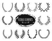 Hand drawn floral doodle design elements — Stock Vector