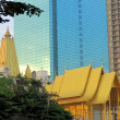 Buddhist temple in front of skyscrapers, Bangkok, Thailand — Photo #66239681