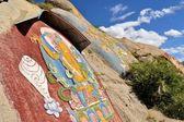 Tibetan prayer stone paintings in the mountains of Lhasa — Stock Photo