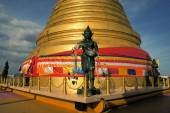 Angel statue with Golden stupa religious icon in Bangkok of Thailand — Stock Photo