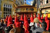 Penitents wear red hoods for the traditional Easter procession in colonial center, La Paz, Bolivia — Stock Photo