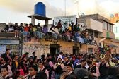Onlookers are watching La Fiesta de la Mama Negra traditional festival — Stock Photo
