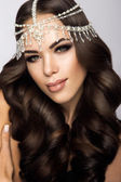 Beautiful bride with wedding makeup and hairstyle, attractive newlywed woman have final preparation for wedding. — Stock Photo