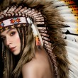 Beautiful ethnic lady with roach on her head. — Stock Photo #70165957