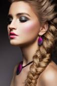 Close-up portrait of beautiful woman with bright make-up — Stock Photo