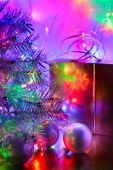 Christmas tree, balls, box, lit by fairy lights — Zdjęcie stockowe