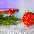 Red Christmas ball, fir branch and with gift box — Stock Photo #59152467