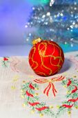 Red Christmas ball on a napkin — Stock Photo