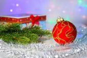 Red Christmas ball, fir branch and with gift box — Stock Photo