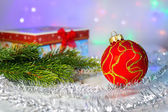 Red Christmas ball, fir branch and with gift box — Stockfoto