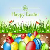 Easter card. Easter eggs, flowers and green grass. — Stock Vector
