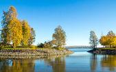 Peaceful ocean bay with a small bridge — Stock Photo