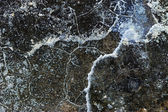 Concrete surface with cracks - texture and background - inverted colors — Stock Photo